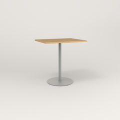 RAD Cafe Table, Rectangular Weighted Base in white oak europly and grey powder coat.