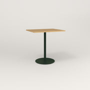 RAD Cafe Table, Rectangular Weighted Base in white oak europly and fir green powder coat.