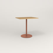RAD Cafe Table, Rectangular Weighted Base in white oak europly and coral powder coat.
