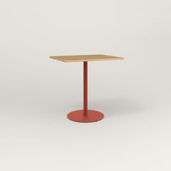 RAD Cafe Table, Rectangular Weighted Base in white oak europly and red powder coat.