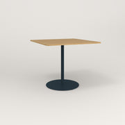 RAD Cafe Table, Rectangular Weighted Base in white oak europly and navy powder coat.
