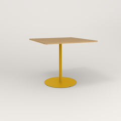 RAD Cafe Table, Rectangular Weighted Base in white oak europly and yellow powder coat.