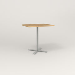 RAD Cafe Table, Rectangular X Base in solid white oak and grey powder coat.