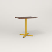 RAD Cafe Table, Rectangular X Base in slatted wood and yellow powder coat.