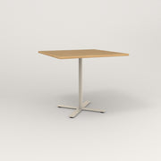 RAD Cafe Table, Rectangular X Base in solid white oak and off-white powder coat.