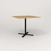 RAD Cafe Table, Rectangular X Base in solid white oak and black powder coat.