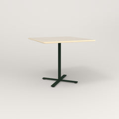 RAD Cafe Table, Rectangular X Base in solid ash and fir green powder coat.