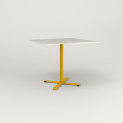 RAD Cafe Table, Rectangular X Base in acrylic and yellow powder coat.