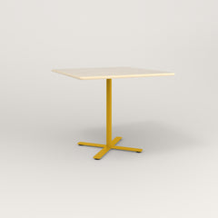 RAD Cafe Table, Rectangular X Base in solid ash and yellow powder coat.