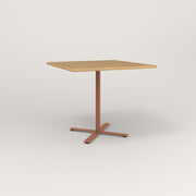 RAD Cafe Table, Rectangular X Base in solid white oak and coral powder coat.