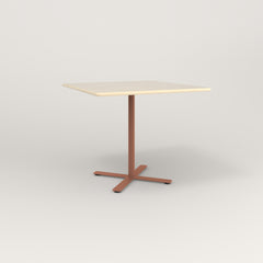 RAD Cafe Table, Rectangular X Base in solid ash and coral powder coat.