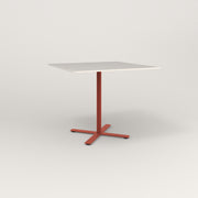 RAD Cafe Table, Rectangular X Base in acrylic and red powder coat.