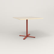 RAD Cafe Table, Rectangular X Base in solid ash and red powder coat.