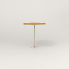 RAD Cafe Table, Round Bolt Down Base in white oak europly and off-white powder coat.