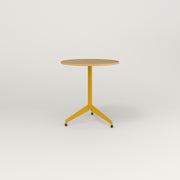 RAD Cafe Table, Round Flat Tripod Base in white oak europly and yellow powder coat.