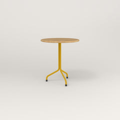 RAD Cafe Table, Round Tube Tripod Base in solid white oak and yellow powder coat.