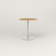 RAD Cafe Table, Round Weighted Base in white oak europly and white powder coat.