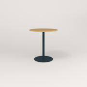 RAD Cafe Table, Round Weighted Base in white oak europly and navy powder coat.