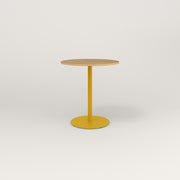 RAD Cafe Table, Round Weighted Base in white oak europly and yellow powder coat.