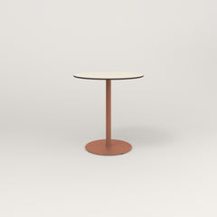 RAD Cafe Table, Round Weighted Base in hpl and coral powder coat.