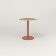RAD Cafe Table, Round Weighted Base in white oak europly and coral powder coat.