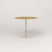 RAD Cafe Table, Round Weighted Base in white oak europly and off-white powder coat.