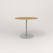 RAD Cafe Table, Round Weighted Base in white oak europly and grey powder coat.