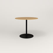 RAD Cafe Table, Round Weighted Base in white oak europly and black powder coat.