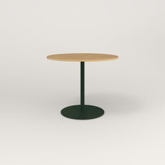 RAD Cafe Table, Round Weighted Base in white oak europly and fir green powder coat.