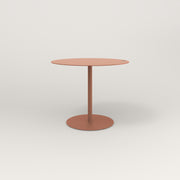 RAD Cafe Table, Round Weighted Base in aluminum and coral powder coat.