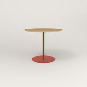 RAD Cafe Table, Round Weighted Base in white oak europly and red powder coat.