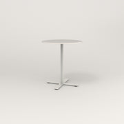 RAD Cafe Table, Round X Base in acrylic and white powder coat.