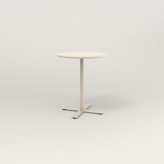 RAD Cafe Table, Round X Base in spun aluminum and off-white powder coat.