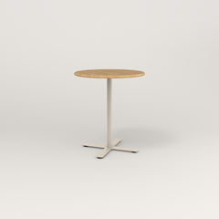 RAD Cafe Table, Round X Base in solid white oak and off-white powder coat.