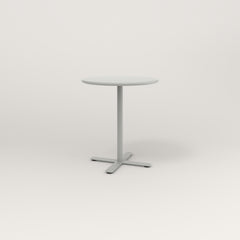 RAD Cafe Table, Round X Base in spun aluminum and grey powder coat.
