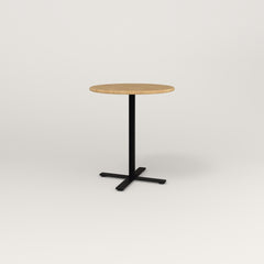 RAD Cafe Table, Round X Base in solid white oak and black powder coat.