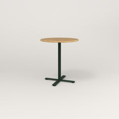 RAD Cafe Table, Round X Base in solid white oak and fir green powder coat.