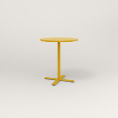 RAD Cafe Table, Round X Base in spun aluminum and yellow powder coat.