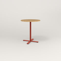 RAD Cafe Table, Round X Base in solid white oak and red powder coat.