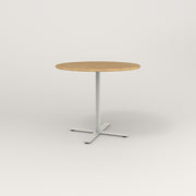 RAD Cafe Table, Round X Base in solid white oak and white powder coat.