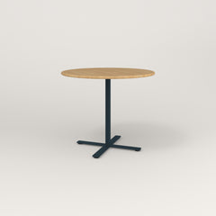 RAD Cafe Table, Round X Base in solid white oak and navy powder coat.