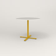 RAD Cafe Table, Round X Base in acrylic and yellow powder coat.