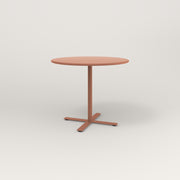 RAD Cafe Table, Round X Base in spun aluminum and coral powder coat.