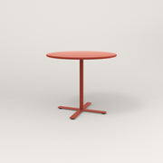 RAD Cafe Table, Round X Base in spun aluminum and red powder coat.