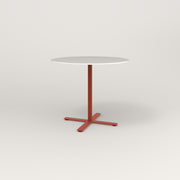 RAD Cafe Table, Round X Base in acrylic and red powder coat.