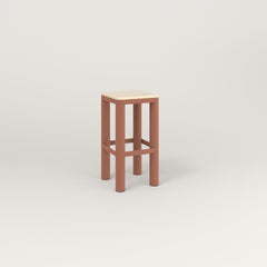 RAD Radius Simple Stool in solid ash and coral powder coat.