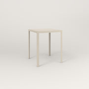RAD Signature Square Cafe Table, in perforated steel and off-white powder coat.