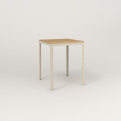 RAD Signature Square Cafe Table, Wood Veneer in off-white powder coat.