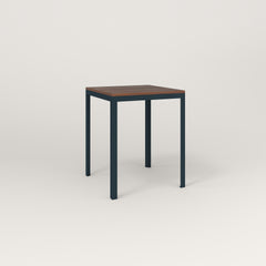 RAD Signature Square Cafe Table, in slatted wood and navy powder coat.