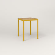 RAD Signature Square Cafe Table, Wood Veneer in yellow powder coat.